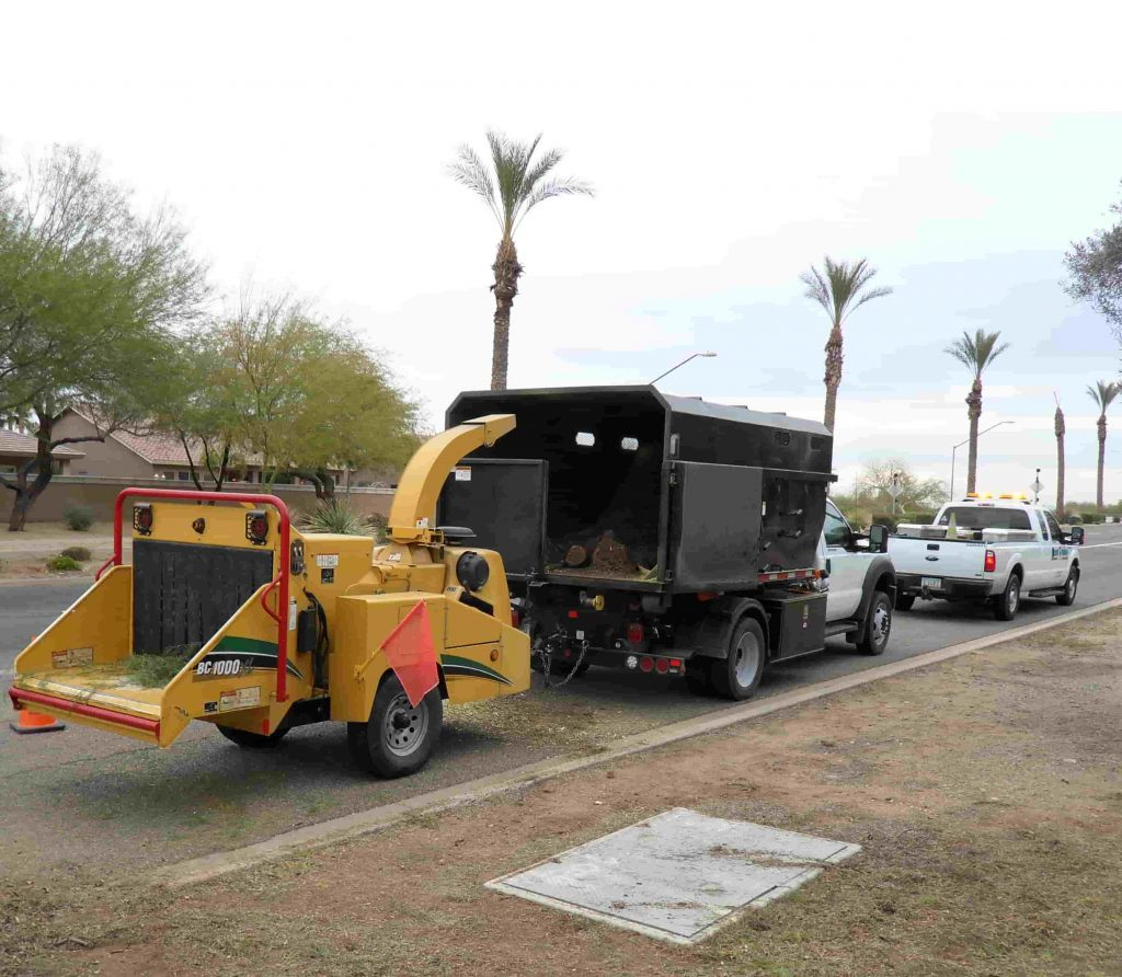 Arbor Body with Chipper Towing behind